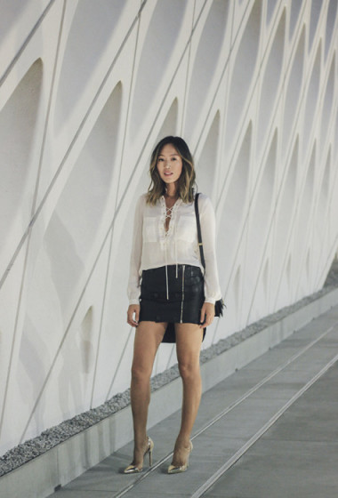 Lace up blouse and leather skirt at The Broad
