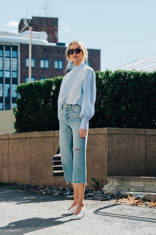 Le Fashion Blog Olso Fashion Week Blue Blouse Cropped Raw Hem Jeans White Kitten Heels Via Vogue Uk