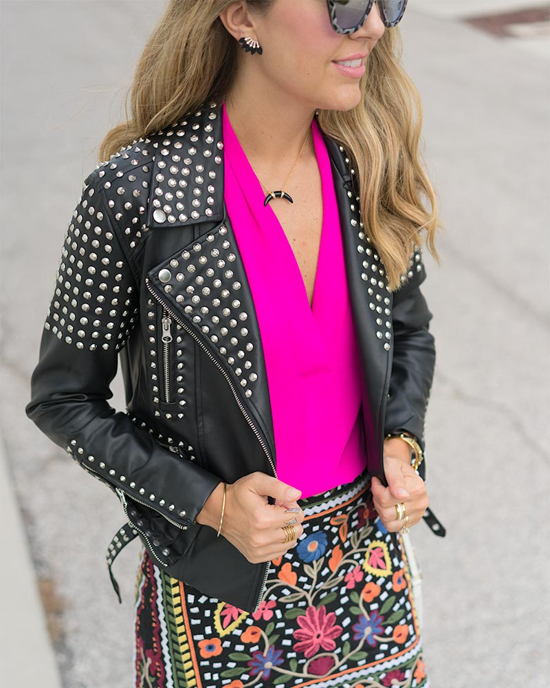 Studded leather jacket, embroidered skirt
