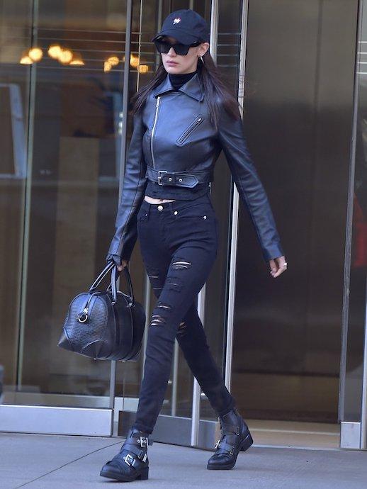 Le Fashion Blog Bella Hadid Black Baseball Hat Black Leather Jacket Black Distressed Skinny Jeans Black Buckle Combat Boots Via Popsugar